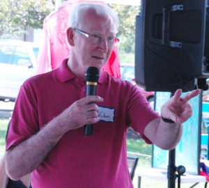 Photo of Dr. Ken Gibson leading a prayer at the Philippine American Heritage Council 4th annual picnic in 2015 in York County PA; in 2016 PAHC co-sponsored an annual picnic with York County Action).